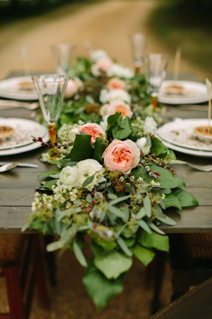 simple rustic floral wedding centerpieces with roses ranunculus and bright leaves