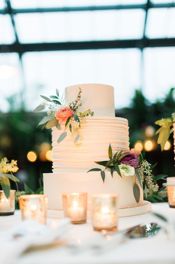 simply elegant wedding cake with peach ranunculus