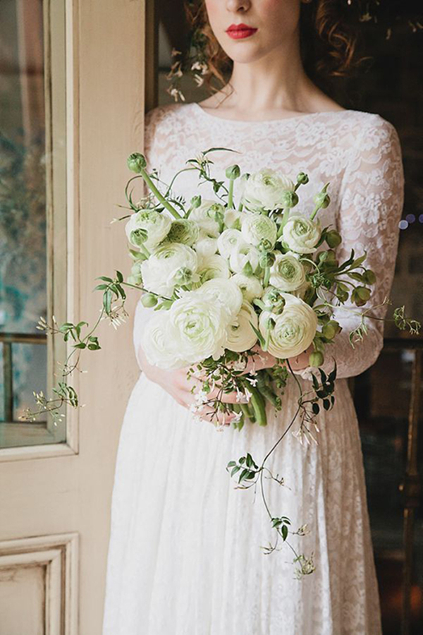 textured white ranunculus wedding bouquet with jasmine vines