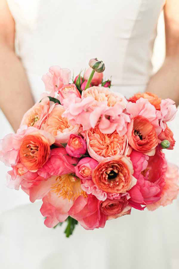 vibrant coral pink wedding bouquets with ranunculuses