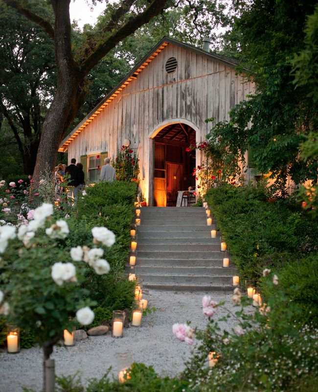 candle lights walkway leading the guests to wedding events
