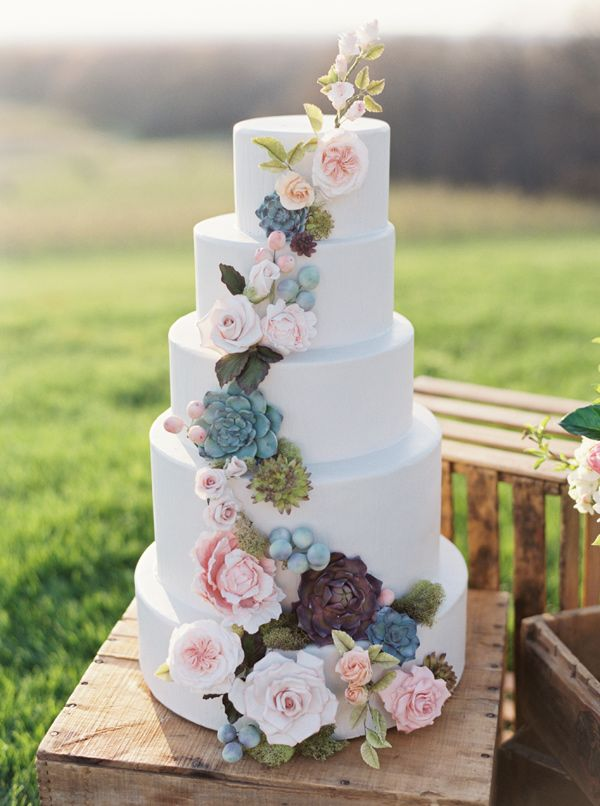 elegant country rustic wedding cake with cascading flower decors