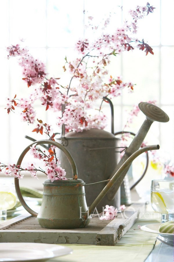 galvanized watering cans with budding flowers for spring wedding centerpiece ideas