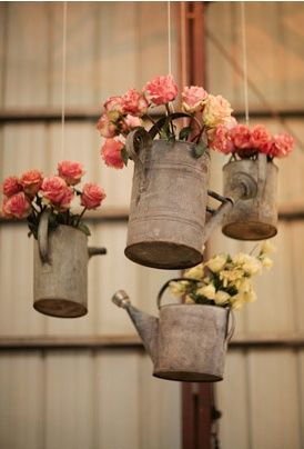18 awesome rustic country wedding ideas to use watering cans hanging watering can flower vases for rustic country wedding ideas junglespirit Image collections