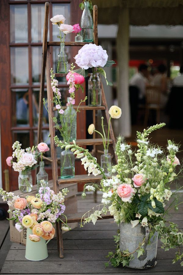 rustic wedding decor ideas with ladder, pop bottles watering can and wild flowers