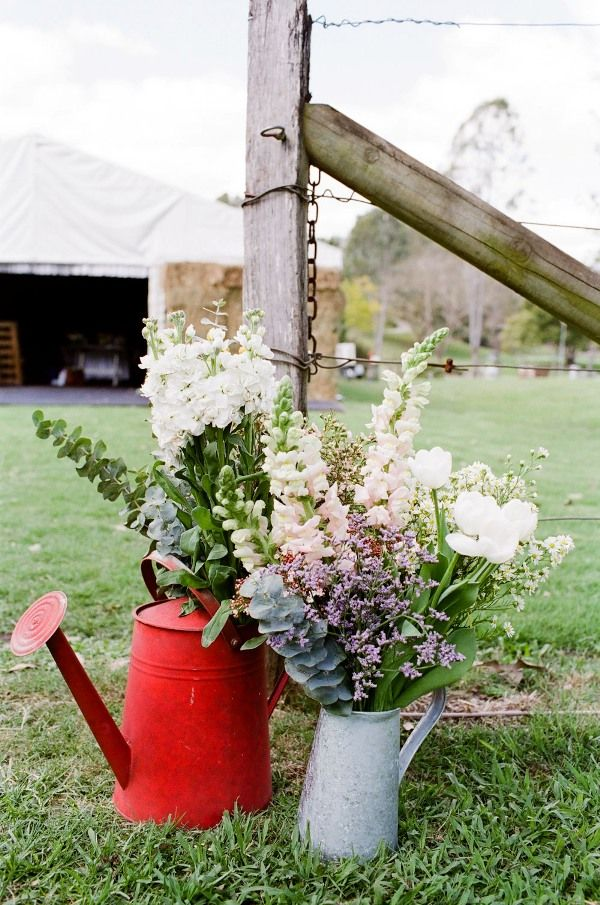 sweet country watering can country wedding decor ideas