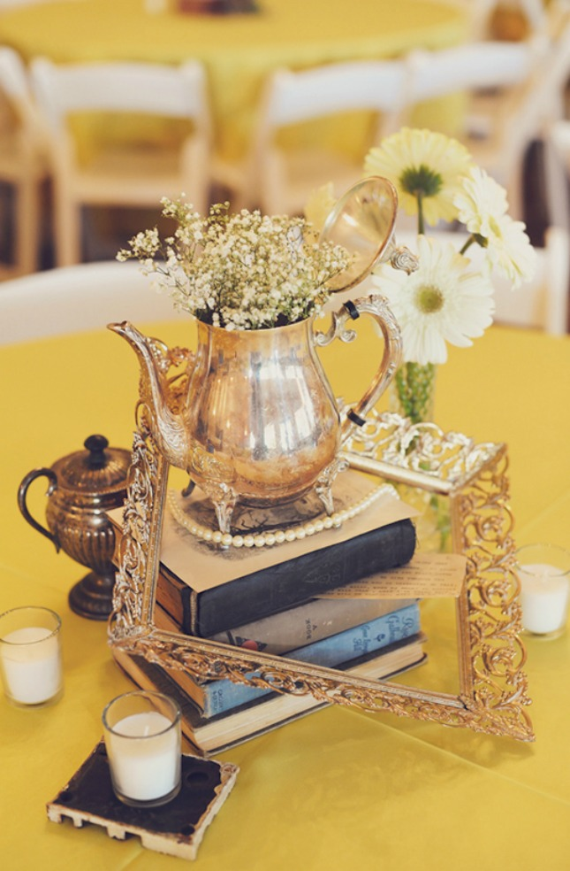 vintage wedding centerpieces of frames, tea pots and old books