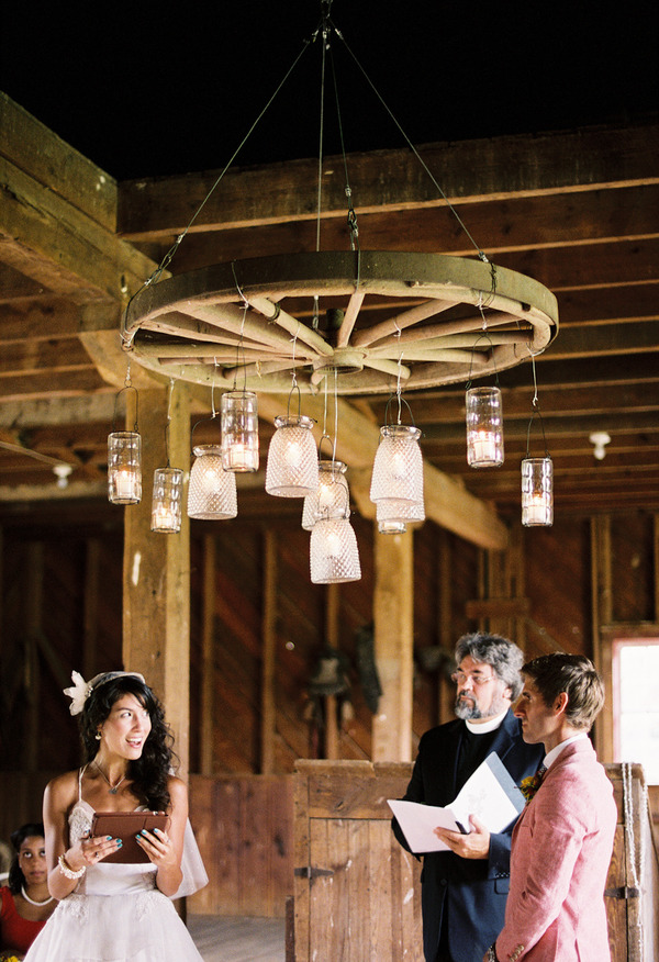 beautiful wedding photos under rustic wagon wheel mason jar chandelier