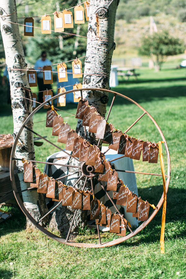 creative rustic wheel name card display wedding ideas