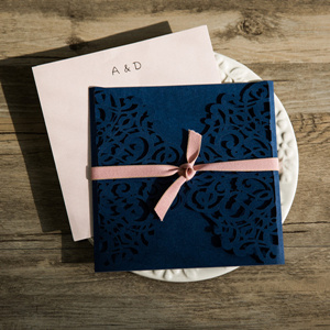 navy blue and blush pink laser cut wedding invitations