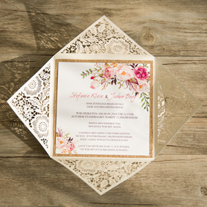 shades of pink and red fall laser cut wedding invitations with a touch of gold glitter