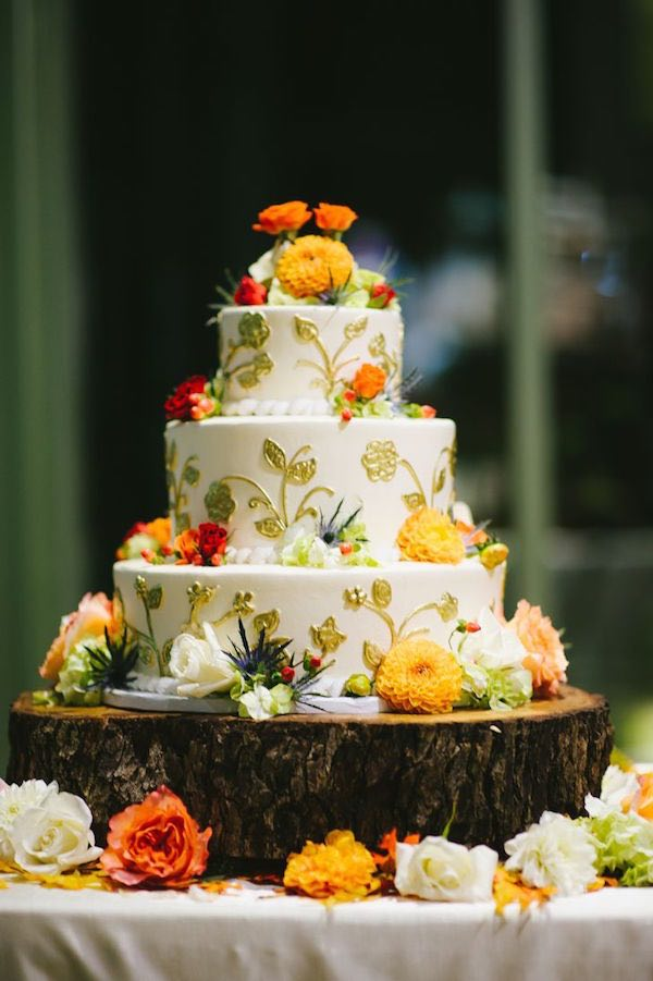 yellow fall wedding cakes with wood stand