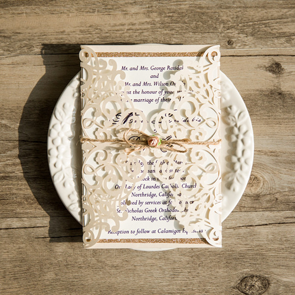 ivory vintage glittery laser cut wedding invitations with twine and soft pink flower