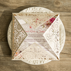 elegant laser cut wedding invitations with a touch of glittery