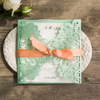 spring mint lace cut with wedding invitation peach ribbon