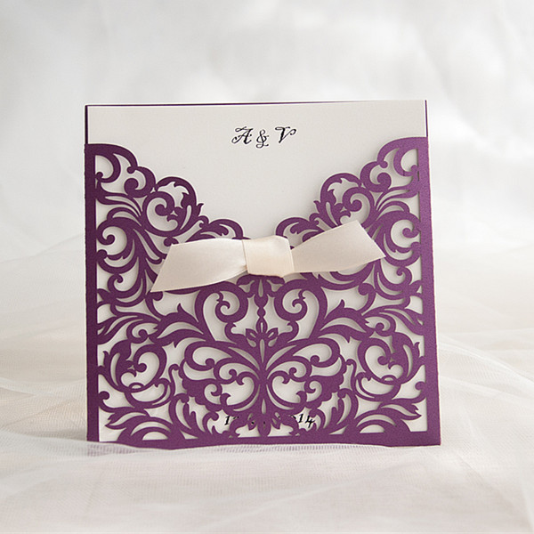 purple laser cut invitations with ivory ribbon