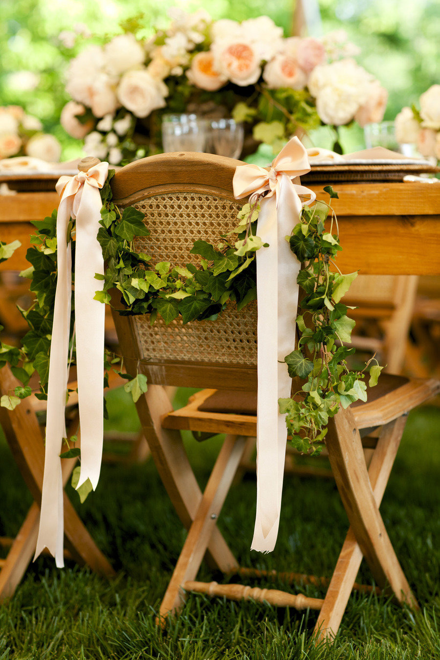 wedding chair decor ideas with greenery garland and satin ribbons