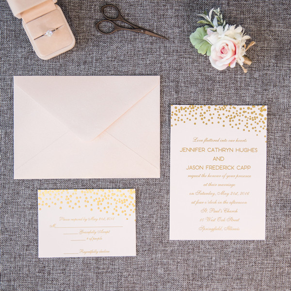 blush pink wedding invitations with foil polka dots and words
