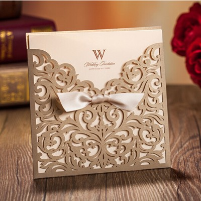 graceful metallic brown laser cut ribbon wedding invitations
