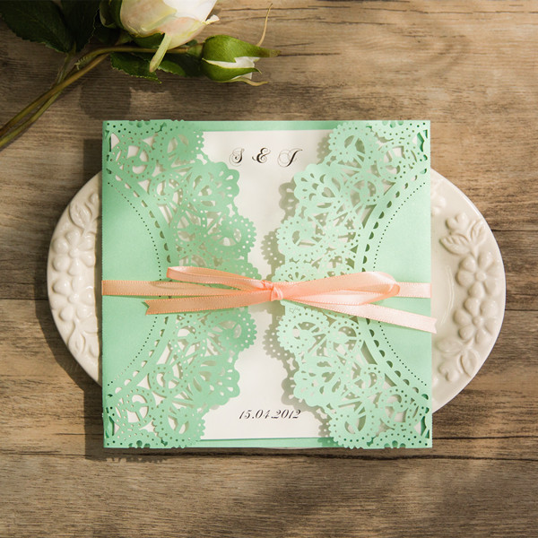 affordable mint and peach ribbon laser cut wedding invites
