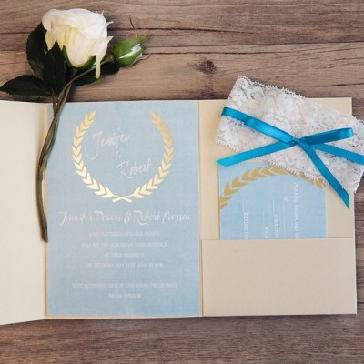dusty blue and gold fold pocket wedding invitations with glitter leaves