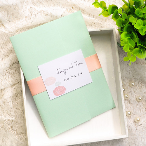 inexpensive mint and peach ribbon dandelion spring wedding invites