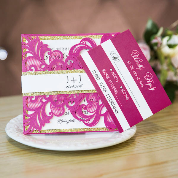 bright fuchsia pink laser cut wedding invitations