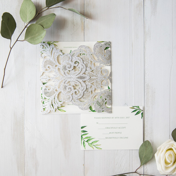 greenery inspired wedding invites with silver laser cut package