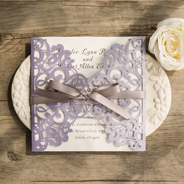 lavender laser cut wedding invites with grey ribbon bows