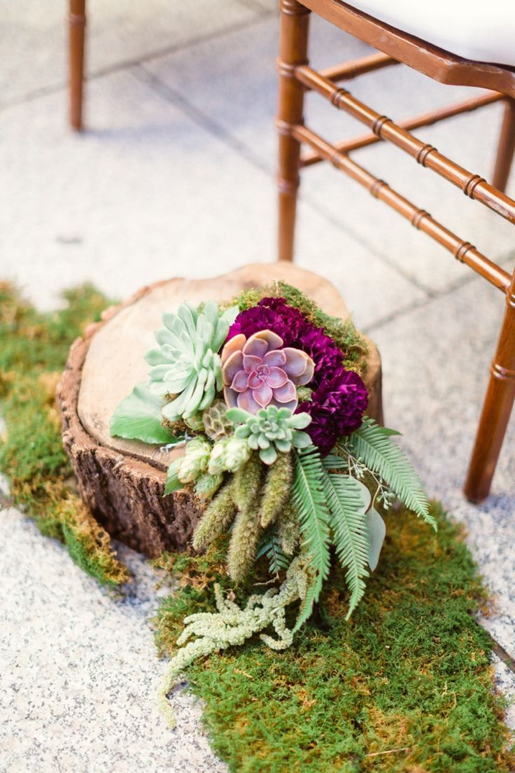 purple and chic nature inspired wedding aisle decor with succulents