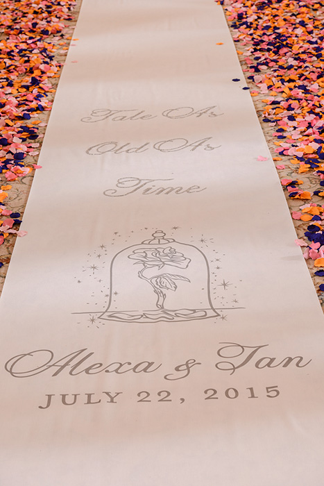 Beauty and the Beast inspired wedidng ceremony aisle runner