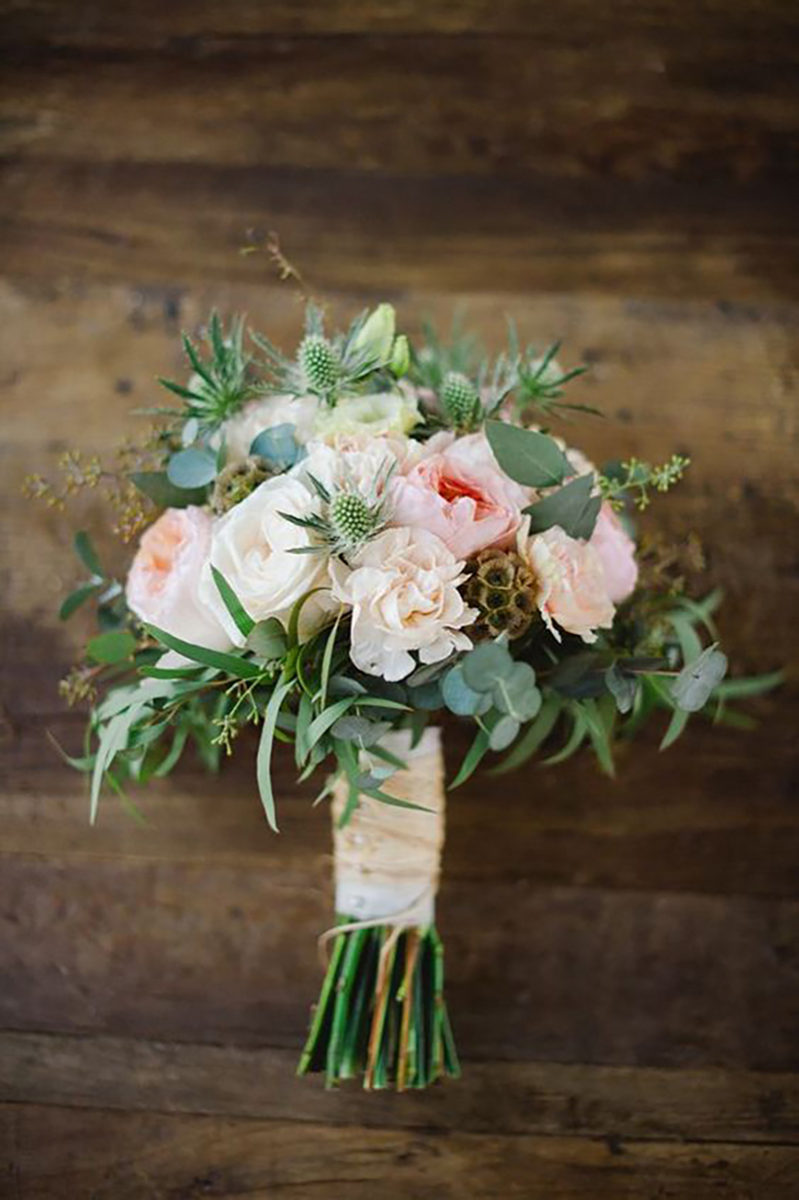 lush pink and white flower bouquets for rustic barn wedding