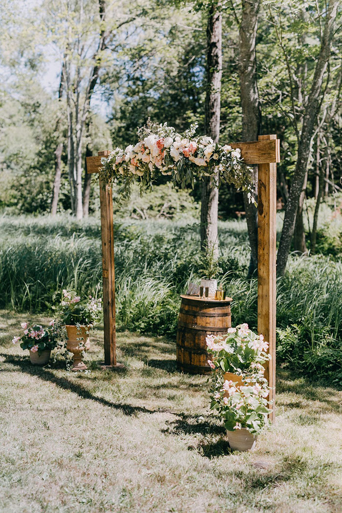 simple wood rustic wedding arches with flowers