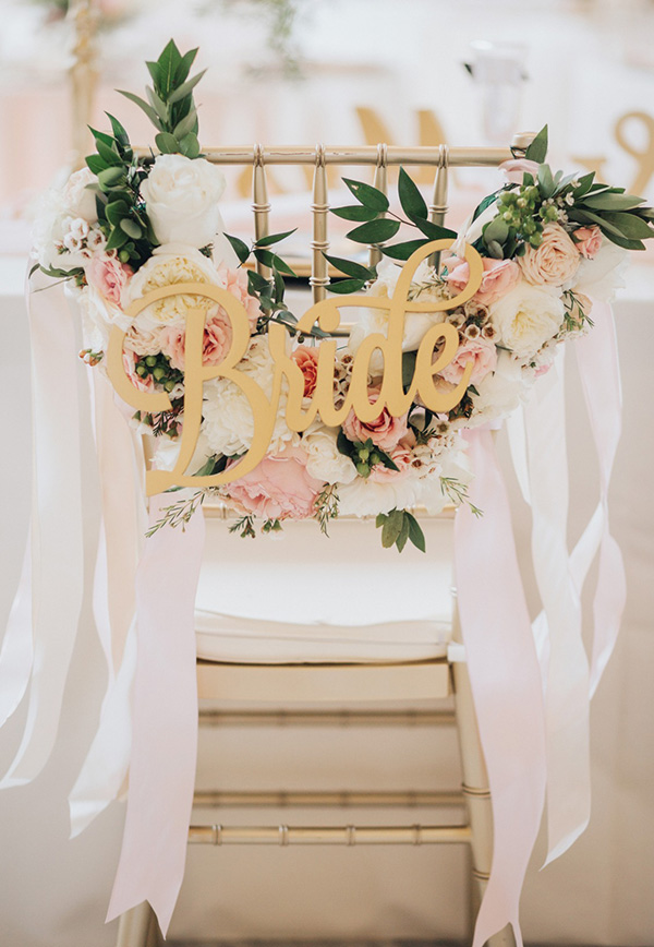 chic blush and gold bride and groom wedding chair decoration