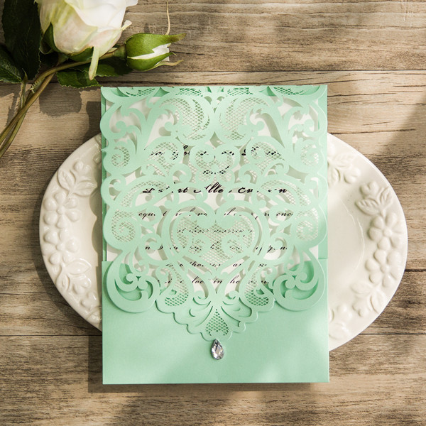 elegant mint green laser cut wedding invites