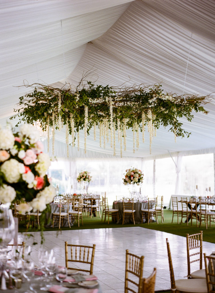 floral chandelier over the dance floor for tented wedding ideas