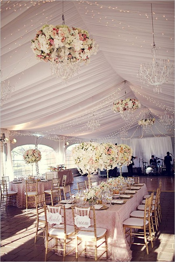 glamour tented wedding with hanging flower chandeliers