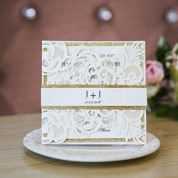 ivory laser cut wedding invitations with glittery bottom cards and bands