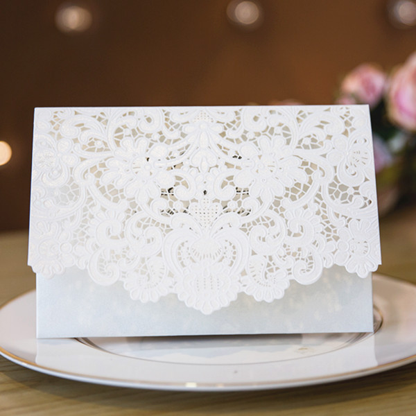 romantic white laser cut wedding invitations