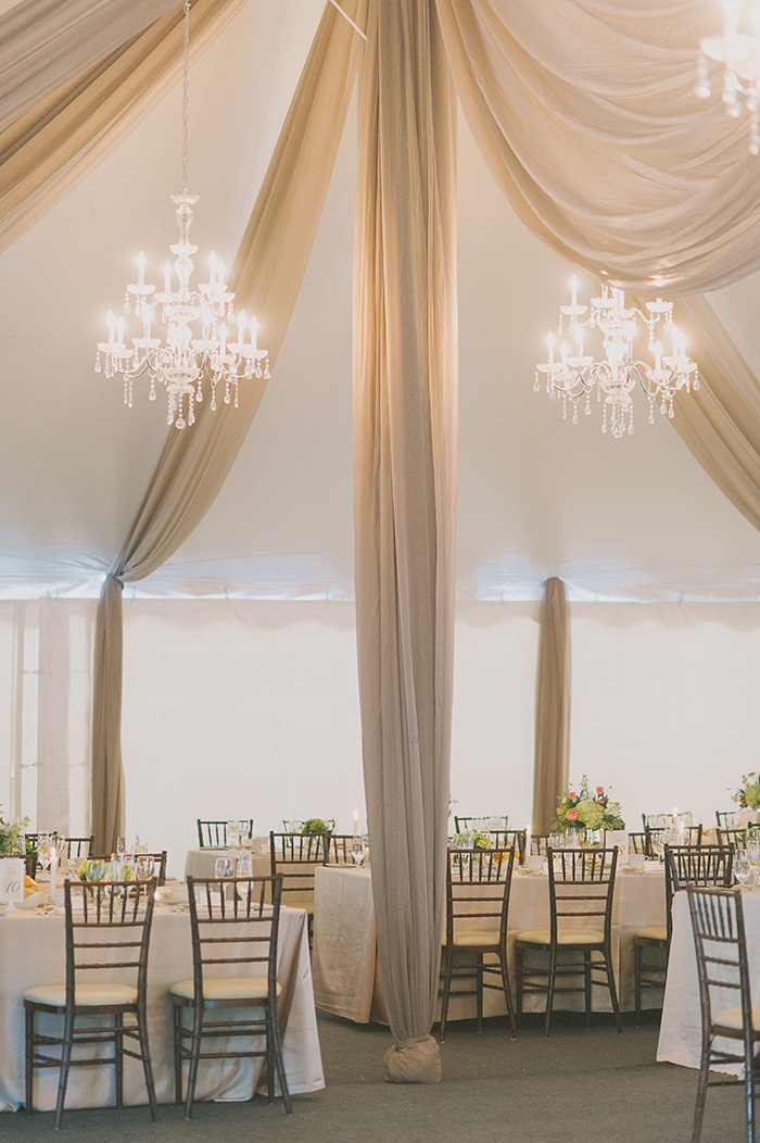 super elegant tented wedding reception ideas with drapery and chandeliers