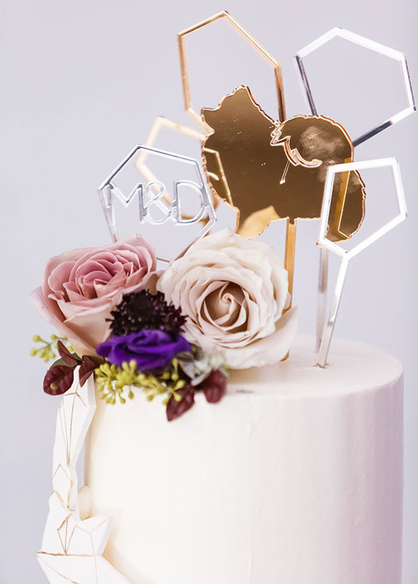 Elegant Floral Wedding Cake with Glitter Silver and Gold Geometric Toppers