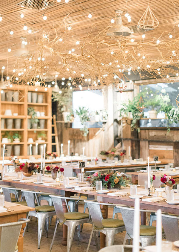 gold geometric and branch wedding reception decor ideas with string lights