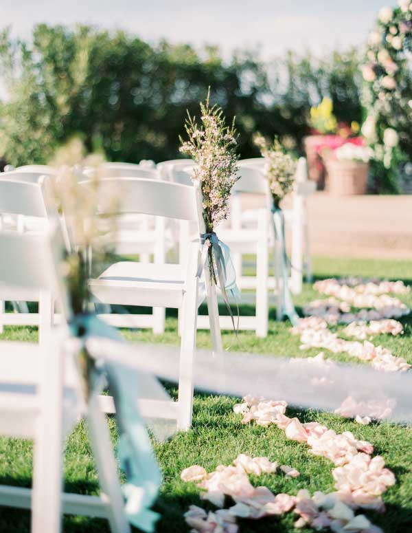 Romantic Garden Wedding Chair Decor with Wildflowers and Blue Ribbon