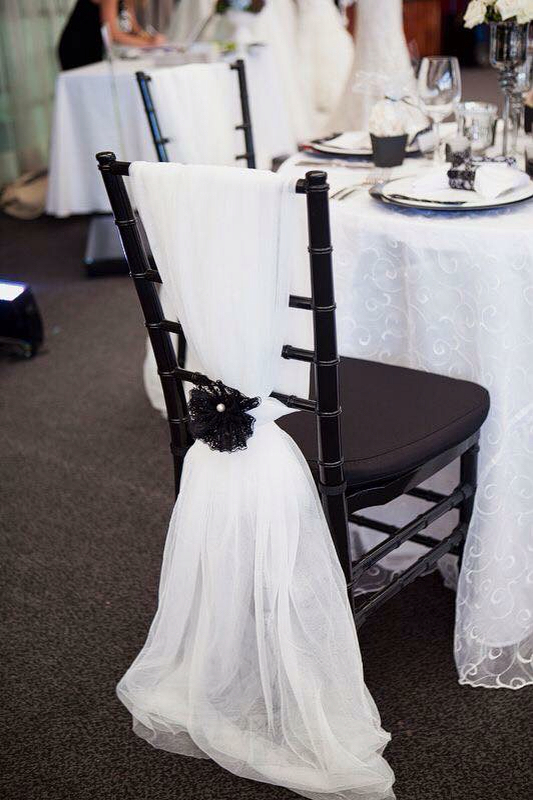 elegant white tulle wedding chair decoration with black fabric flower