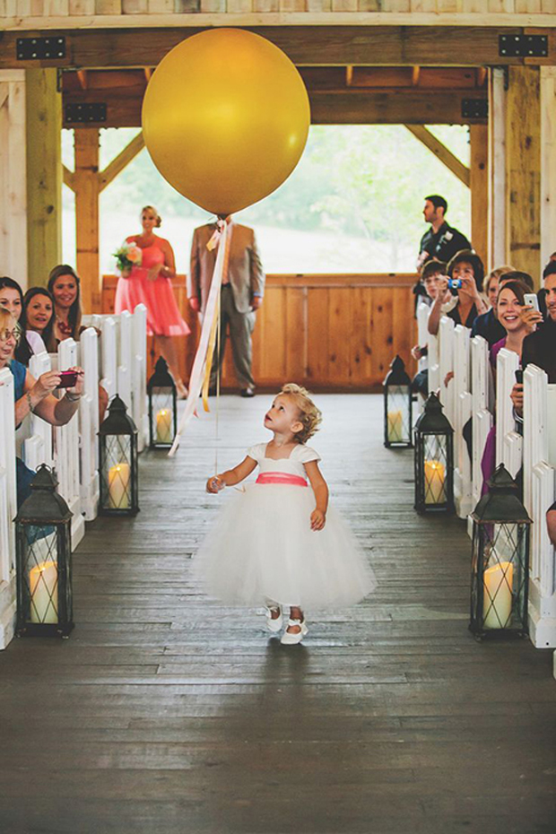 flower girl wedding photo with balloon