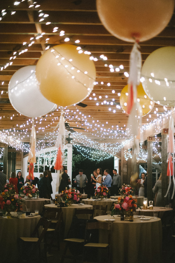 gorgeous wedding reception decor with giant balloons and twinkly lights!