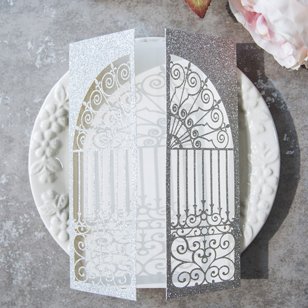 laser cut silver glitter gate wedding invites