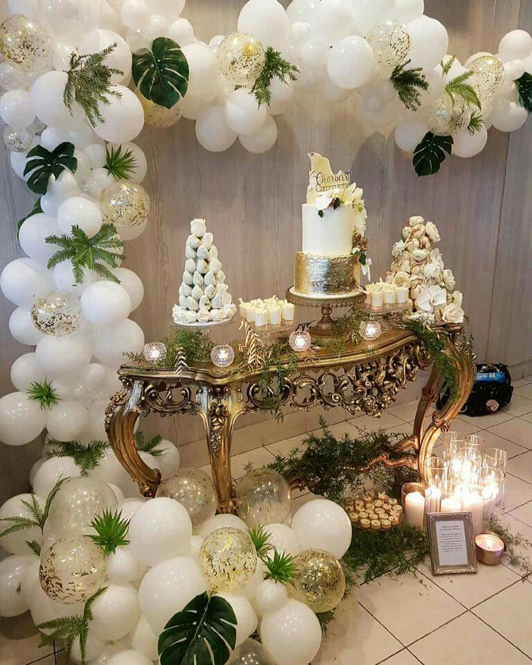 lovely huge huge white balloon garland decoration with greenery