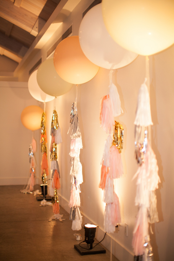 wedding ideas with balloons lining the walls with uplighting