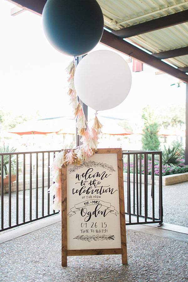 wedding welcome sign board decorated with balloons